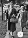 2 of the members leaving the centre walking along Magdalen Way.