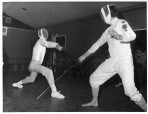 2 Members giving a fencing display