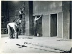 Members working on barn during the conversion to gymnasium